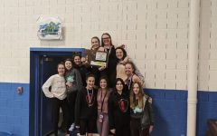 Hellgate's Girl's 2020 State Swim Team, holding their 2nd place plaque at the conclusion of the meet. Photo courtesy of Addy Lewis.