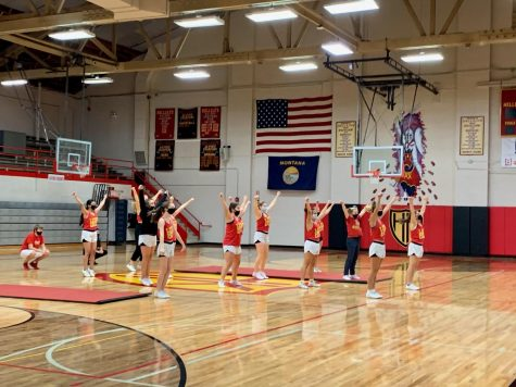The cheerleaders rehearse their competition routine at practice before school.