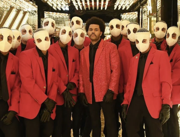 The Weeknd with his backup dancers in the hall of mirrors (photo courtesy of Insider)