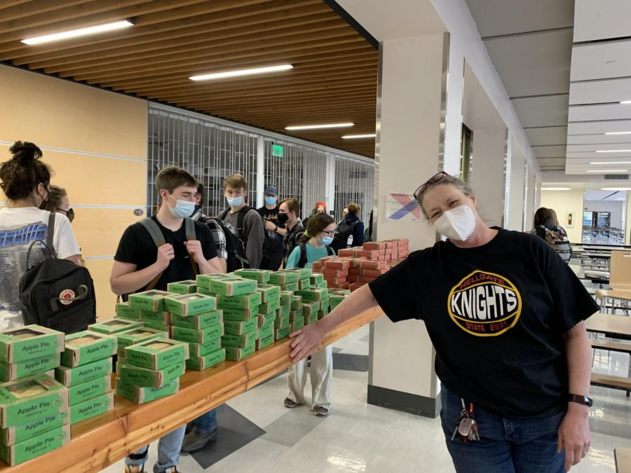 Hellgate math teacher Alexandra (Zandy) Startin poses in front of some of the 628 pies she secured for Hellgate students to celebrate Pi Day.