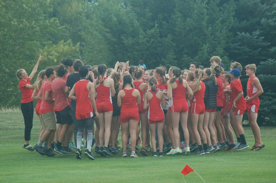 The+Hellgate+Cross+Country+team+gathering+together+for+a+cheer+before+a+race.+Photo+courtesy+of+Hellgate+Cross+Country